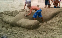 Giant Hammerhead Shark being carved out of sand on Kauai