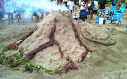 Smoking Volcano sand sculpture with red ti leaf lava